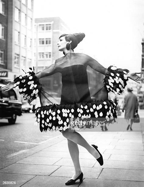 Ann Milling models a cocktail dress in organza trimmed with feathers from the Christian Dior London SpringSummer Collection 1967