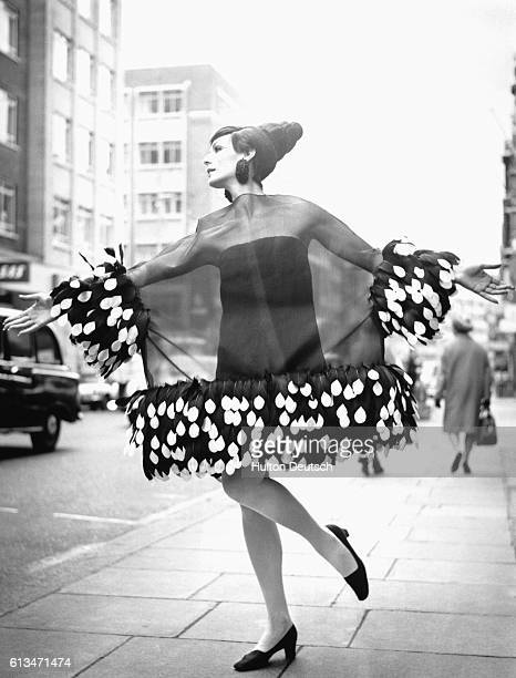 Ann Milling models a feathertrimmed organza cocktail dress from Christian Dior's spring/summer collection 1967