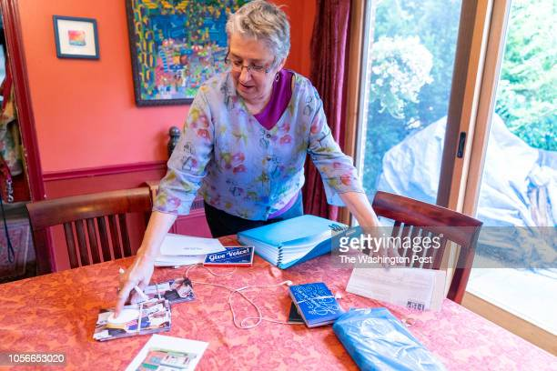 Ann Mintz sifts through her postcarding folder in her home in the Mt Airy neighborhood of Philadelphia Pennsylvania on August 3 2018 Mintz is a...
