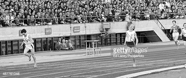 Ann Packer of Great Britain silver medallist in the women's 400 metres event followed by Judy Amoore of Australia during the Summer Olympic Games in...