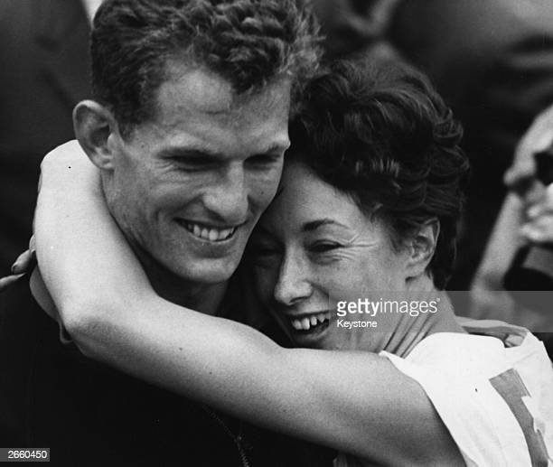 Ann Packer of Great Britain winner of the 800 metres final at the 1964 Tokyo Olympics gives her boyfriend Robbie Brightwell captain of the British...