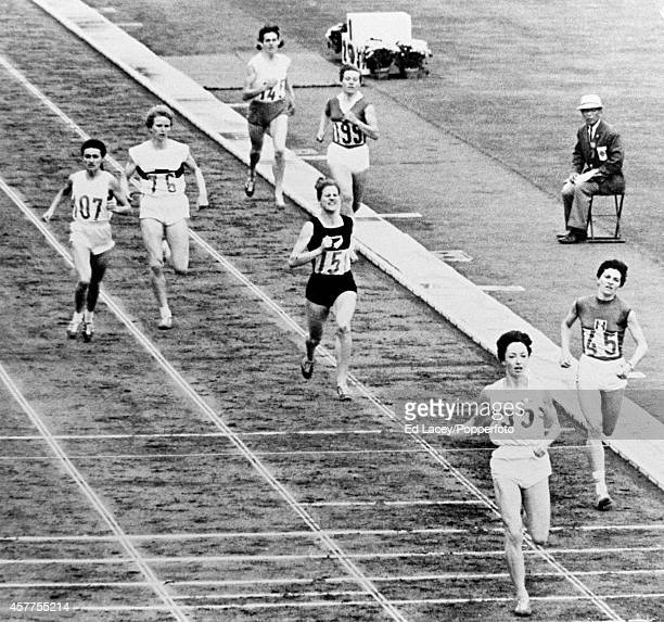 Ann Packer of Great Britain wins the women's 800 metres final with Maryvonne Dupureur of France second and Marise Chamberlain of New Zealand third...