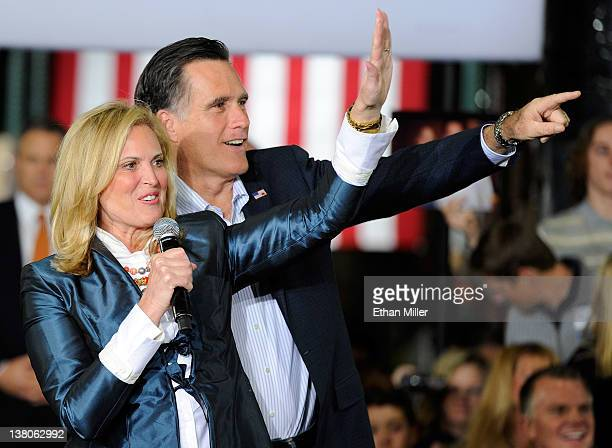 Ann Romney and her husband Republican presidential candidate former Massachusetts Gov Mitt Romney point to children in the crowd during a campaign...