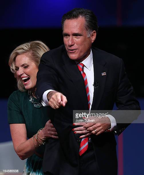 Ann Romney grabs her husband Republican presidential candidate Mitt Romney at the conclusion of a debate with US President Barack Obama at the Keith...