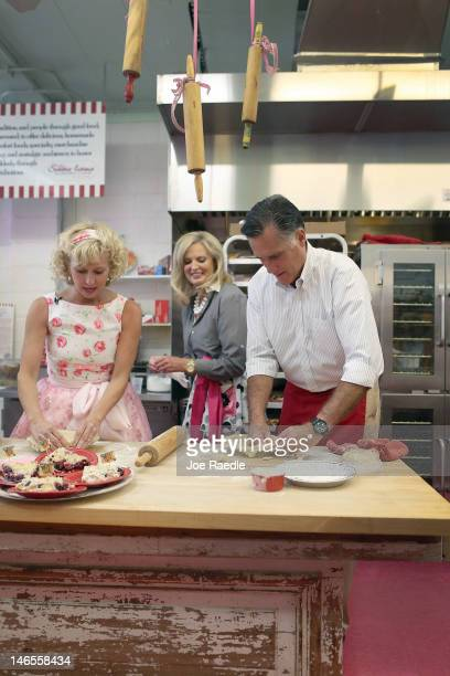 Ann Romney looks on as her husband Republican presidential candidate former Massachusetts Gov Mitt Romney makes a pie shell with the help of...