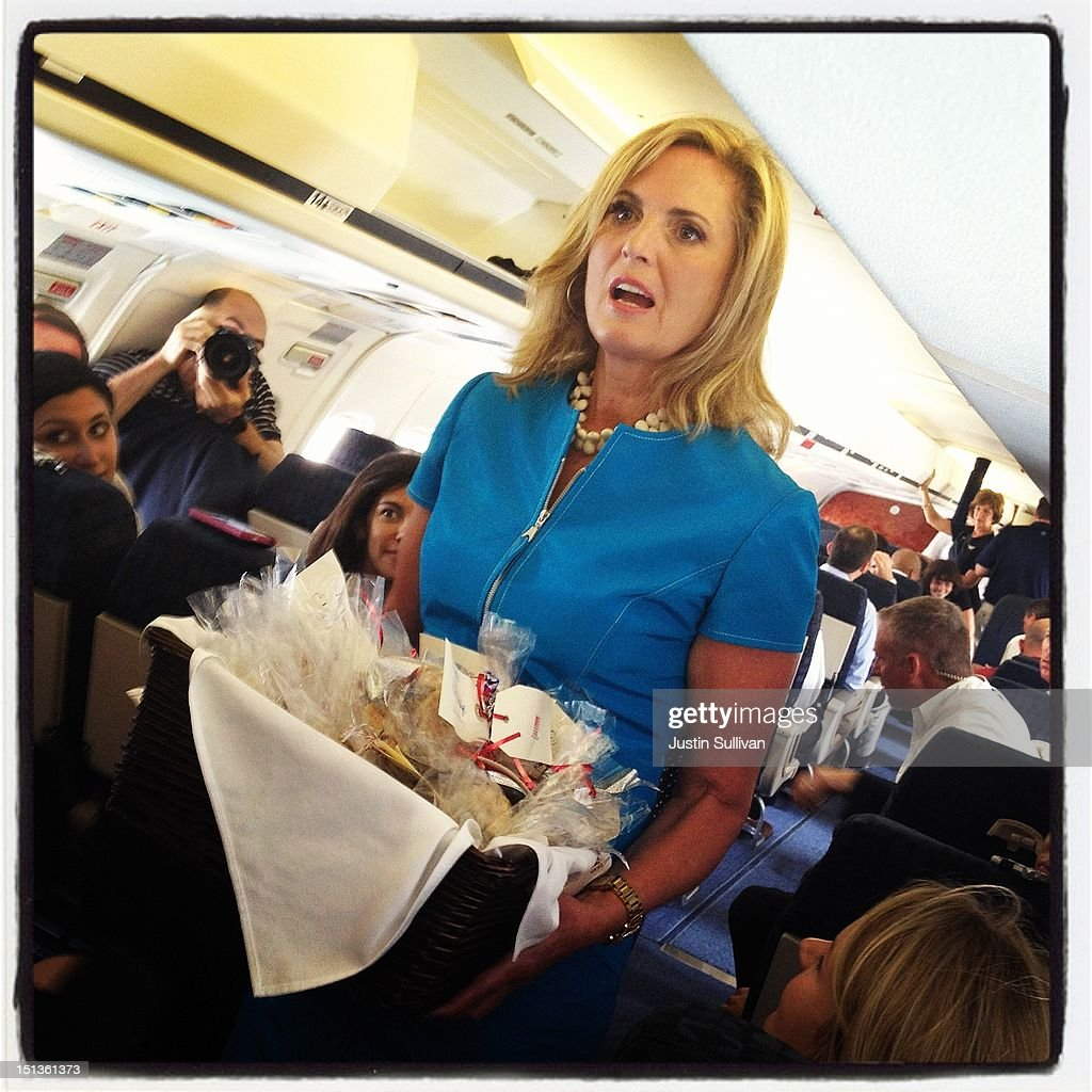 Ann Romney, wife of Republican presidential candidate, former Massachusetts Gov. Mitt Romney, passes out homemade Welsh Cakes to members of the traveling press aboard the campaign plane on September 1, 2012 in Cincinnati, Ohio. Mitt Romney will hold campaign events in Ohio and Florida.
