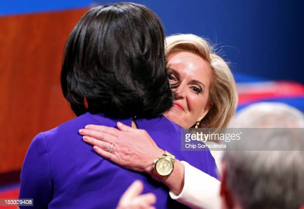 Ann Romney wife of Republican presidential candidate former Massachusetts Gov Mitt Romney and First lady Michelle Obama hug prior to the Presidential...