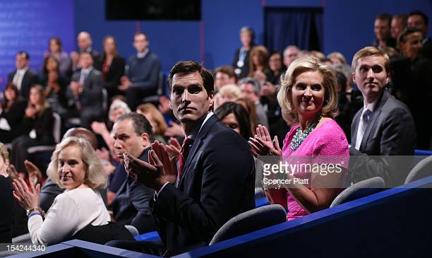 Ann Romney wife of Republican presidential candidate Mitt Romney and her sons Ben Romney and Josh Romney sit in their seats prior to the start of the...