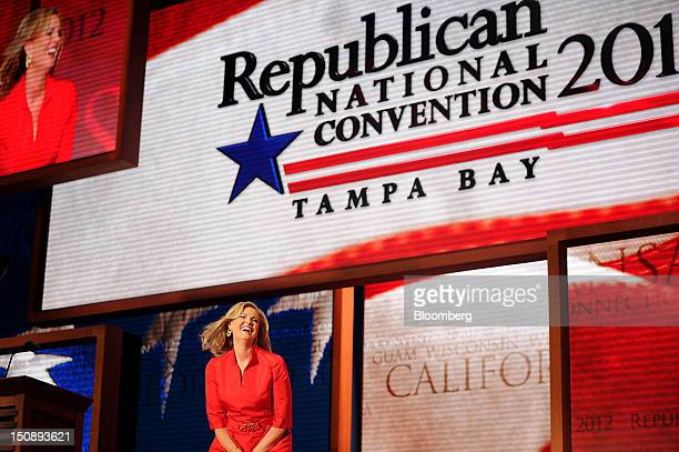 Ann Romney wife of Republican presidential candidate Mitt Romney smiles before speaking at the Republican National Convention in Tampa Florida US on...