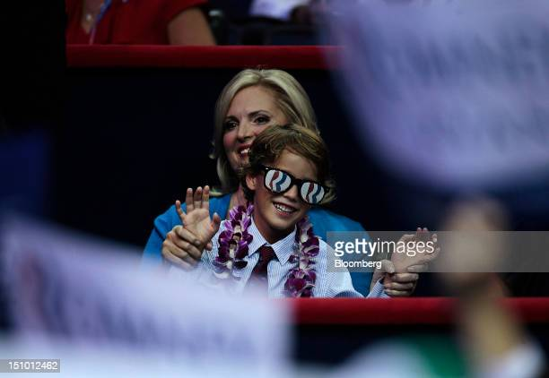 Ann Romney wife of Republican presidential candidate sits with her grandson at the Republican National Convention in Tampa Florida US on Thursday Aug...