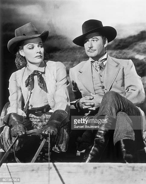 Ann Sheridan and Errol Flynn on the movie set of Silver River directed by Raoul Walsh