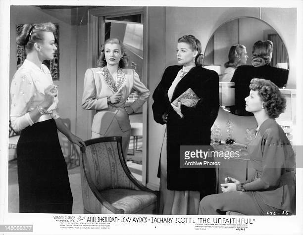 Ann Sheridan and Eve Arden standing with two other women in a scene from the film 'The Unfaithful' 1947
