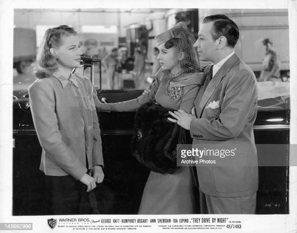 Ann Sheridan facing Ida Lupino and George Raft in a scene from the film 'They Drive By Night' 1940
