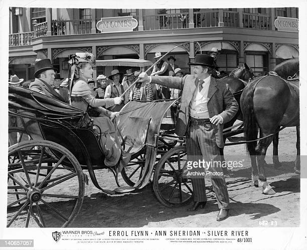 Ann Sheridan in horse carriage in a scene from the film 'Silver River' 1948