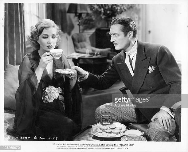 Ann Sothern is offered coffee by Edmund Lowe in a scene from the film 'Grand Exit' 1935