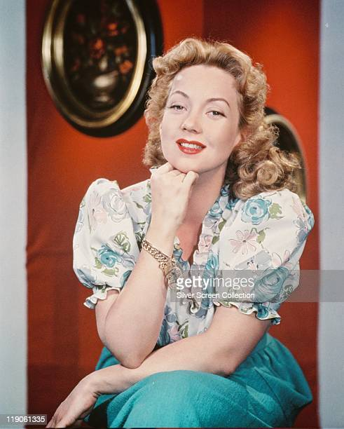 Ann Sothern US actress posing wearing a blue and white outfit with her chin resting on her right hand circa 1940