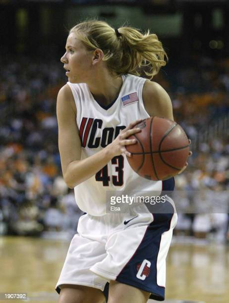 Ann Strother of the University of Connecticut Huskies attempts to pass the ball against the defense of the University of Texas at Austin Longhorns...