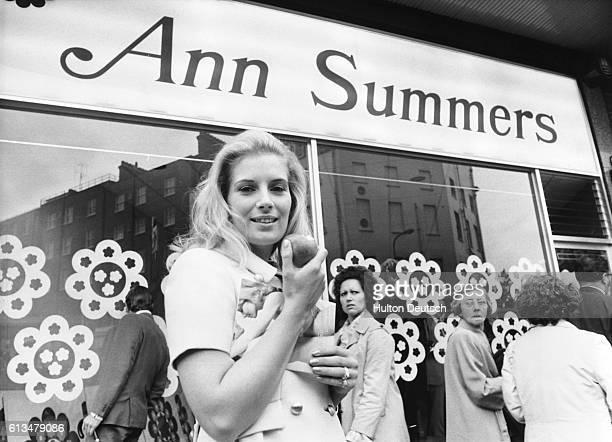 Ann Summers eats an apple outside her underwear shop on the Edgeware Road in London ca 1970   Location Edgeware Road London England UK