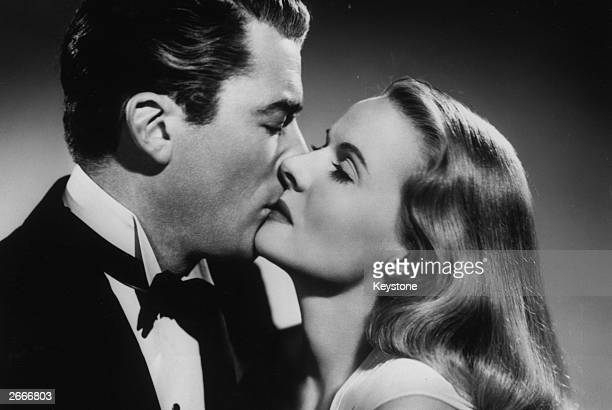 Ann Todd and Gregory Peck exchange a kiss in a scene from 'The Paradine Case' directed by Alfred Hitchcock