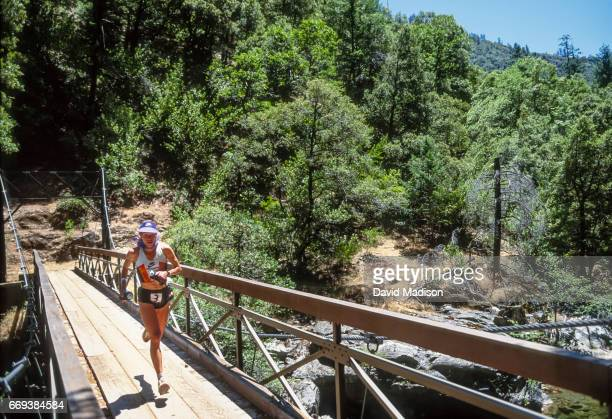 Ann Trason of the United States runs across Swinging Bridge over the American River during the Western States 100 ultramarathon trail race on June 25...