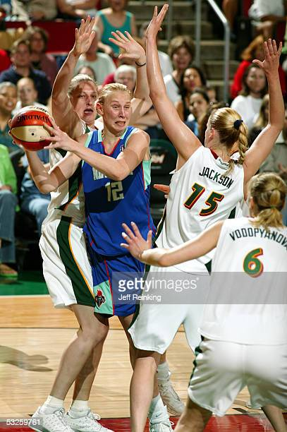 Ann Wauters of the New York Liberty looks to pass as Lauren Jackson and Suzy Batkovic of the Seattle Storm defend on July 19 2005 at Key Arena in...