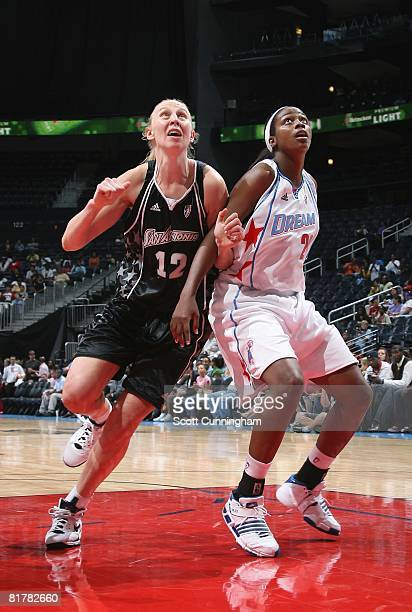 Ann Wauters of the San Antonio Silver Stars gets in position to rebound against Camille Little of the Atlanta Dream during the WNBA game on June 18...