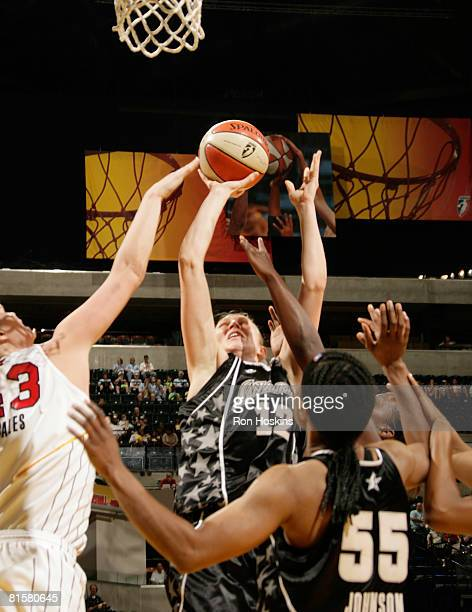 Ann Wauters of the San Antonio Silver Stars shoots over Alison Bales of the Indiana Fever at Conseco Fieldhouse on June 15 2008 in Indianapolis...