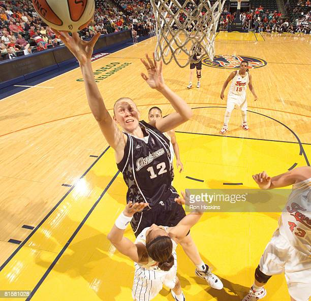 Ann Wauters of the San Antonio Silver Stars shoots over Tully Bevilaqua of the Indiana Fever at Conseco Fieldhouse on June 15 2008 in Indianapolis...