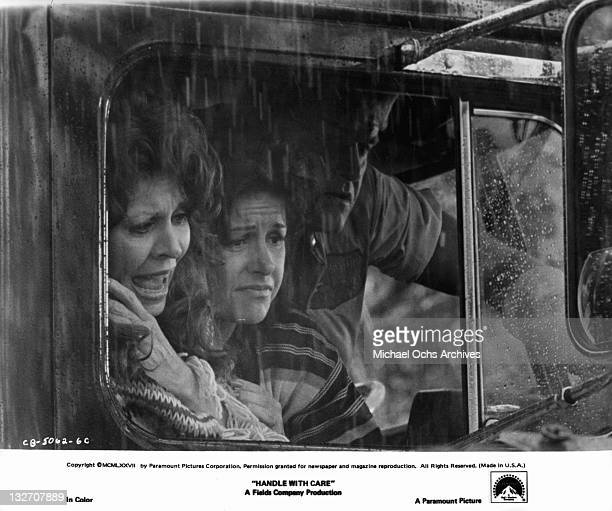 Ann Wedgeworth Marcia Rodd and Charles Napier discover that their pickup truck is stuck in the mud during a heavy rainfall in a scene from the film...