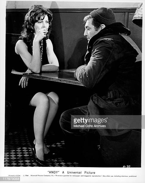 Ann Wedgeworth smoking a cigarette while looking at Norman Alden in a scene from the film 'Andy' 1965