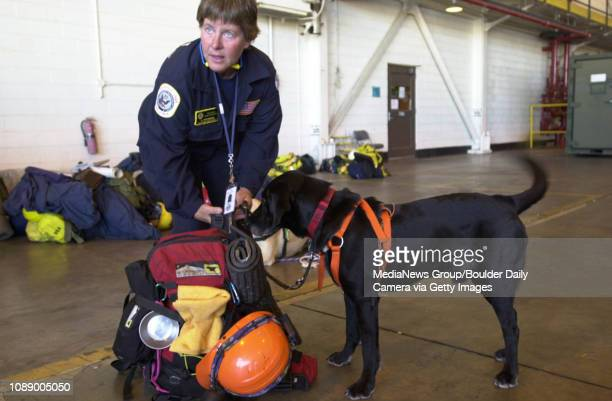Ann Wichmann an environmental resources manager with the city of Boulder and her 9 year old rescue dog Jenner prepare for a flight with firefighters...