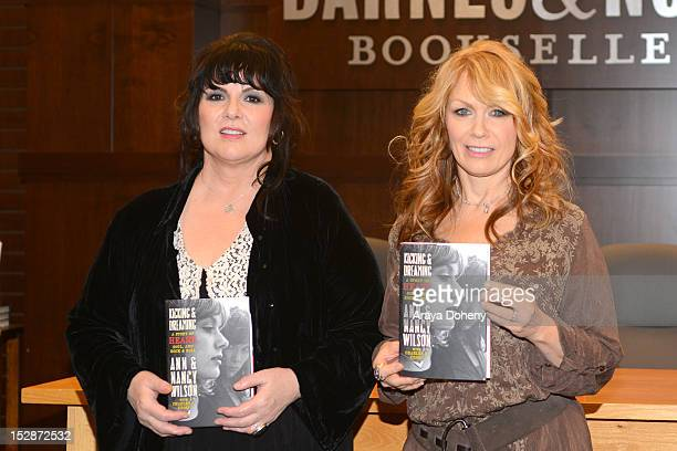 Ann Wilson and Nancy Wilson of Heart sign copies of their memoir Kicking And Dreaming at Barnes Noble bookstore at The Grove on September 27 2012 in...