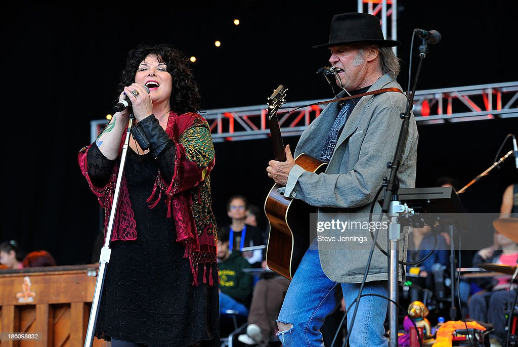 Ann Wilson and Neil Young (L-R) perform on Day 2 of the 27th Annual Bridge School Benefit concert at Shoreline Amphitheatre on October 27, 2013 in Mountain View, California.