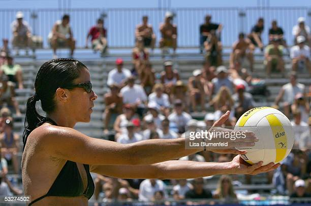 Ann Windes, in a team with Saralyn Smith, prepares to serve during the AVP Hermosa Beach Open match against Kerri Walsh and Misty May-Treanor at the...