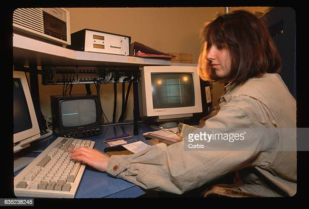 Ann Zabludoff uses a computer keyboard to operate the 100inch telescope at Las Campanas Observatory in Chile She works at 300 am integrating the...