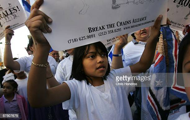 Anna a child of a family from El Salvador join thousands in a rally against proposed crackdowns on illegal immigrants May 1 2006 in Union Square in...