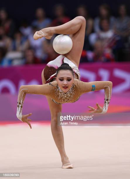 Anna Alyabyeva of Kazakhstan performs with the ball during the Rhythmic Gymnastics qualification on Day 13 of the London 2012 Olympics Games at...