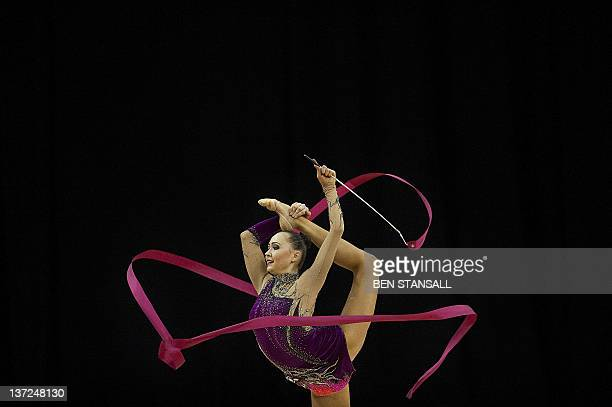 Anna Alyabyeva of Kazakhstan performs with the ribbon during the qualification round of the Rhythmic Gymnastics London 2012 Olympic qualifier a part...