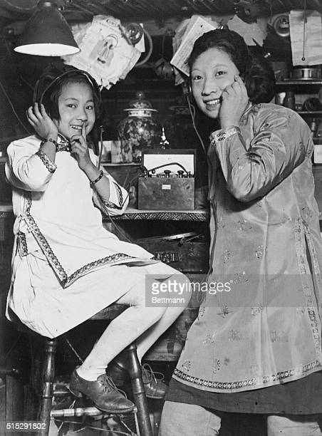 Anna and Lilly Chow of San Francisco's Chinatown listen to the radio together
