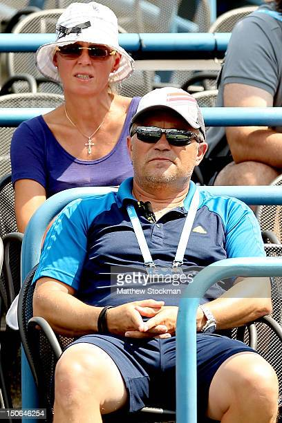 Anna and Piotr Wozniacki parents of Caroline Wozniacki of Denmark watche as she plays Dominika Cibulkova of Slovakia during the New Haven Open at...