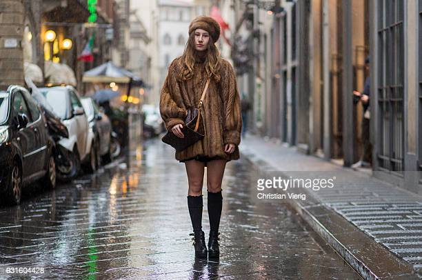 Anna Angelica Godoli is wearing a fur coat and fur hat Louis Vuitton bag knee socks ankle boots on January 13 2017 in Florence Italy
