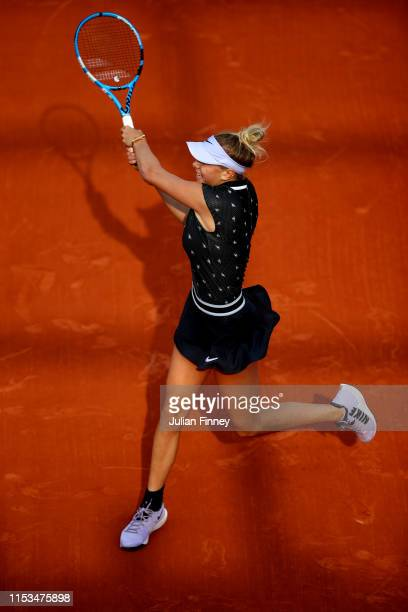 Anna Anisimova of The United States plays a backhand during her ladies singles fourth round match against Aliona Bolsova of Spain during Day nine of...