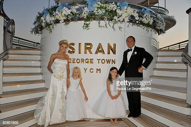 ACCESS*** Anna Anka and Paul Anka pose with Tilda Lilja and Elli during their wedding on the yacht MY Siran on July 26 2008 in Porto Cervo Sardinia...