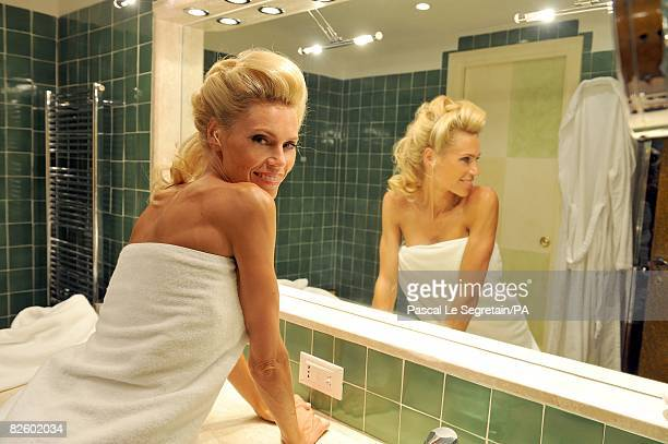 ACCESS*** Anna Anka poses in her bathroom at the Hotel Cala di Volpe as she getting ready for her wedding with Paul Anka on July 26 2008 in Porto...