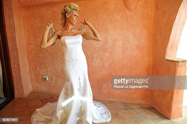 ACCESS*** Anna Anka poses in her wedding dress before her wedding with Paul Anka celebrated in front of the yacht MY Siran docked at Cala di Volpe...