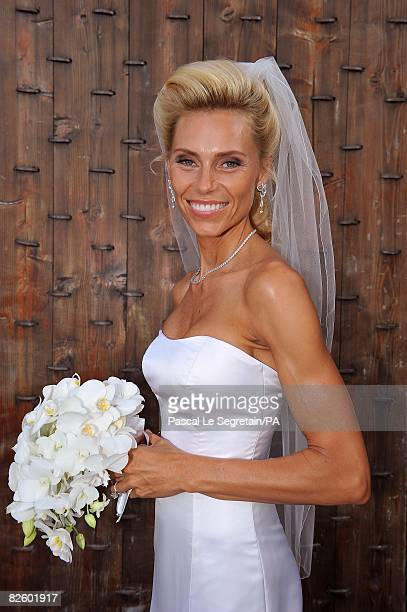 ACCESS*** Anna Anka poses in her wedding dress during her wedding with Paul Anka celebrated in front of the yacht MY Siran docked at Cala di Volpe...