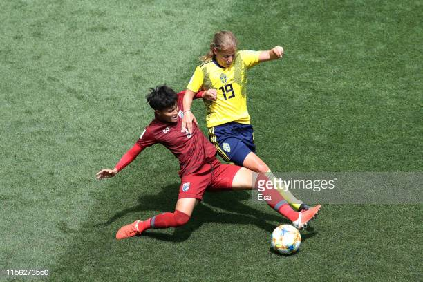 Anna Anvegard of Sweden is challenged by Natthakarn Chinwong of Thailand during the 2019 FIFA Women's World Cup France group F match between Sweden...