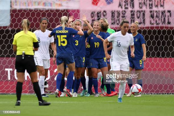 Anna Anvegard of Team Sweden celebrates with team mates after scoring their side's first goal during the Women's Group G match between New Zealand...