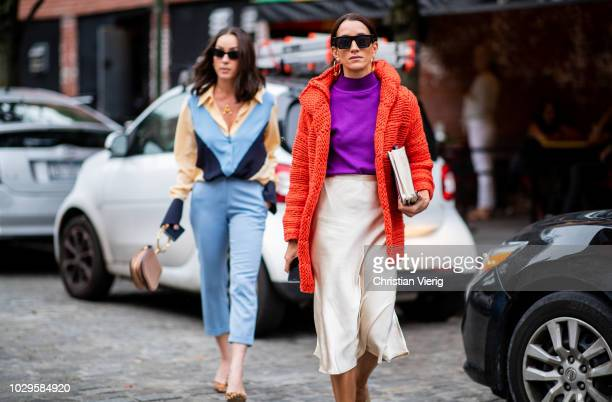 Anna Aronov wearing blue cropped pants and button shirt and Meital Katz wearing red teddy jacket silk skirt purple turtleneck seen outside Jonathan...