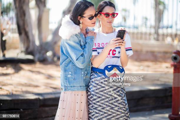 Anna Aronov wearing denim jacket and Meital Katz wearing white tshirt with Brooklyn printed metallic midi skirt Gucci fanny bag is seen during Tel...